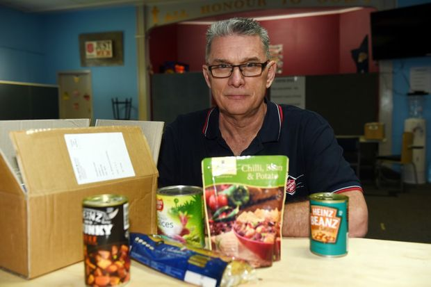 Major Bruce Ellicott with some of the food parcels they hand out. Photo Vicki Wood / Caboolture News