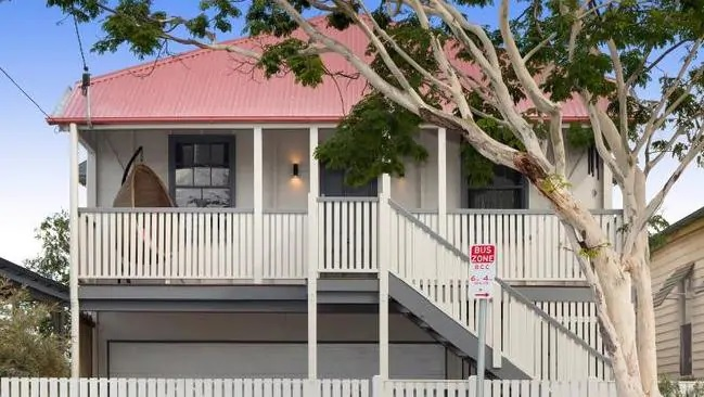 Brisbane's property market continues to fire with almost a dozen suburbs hitting double digit price growth