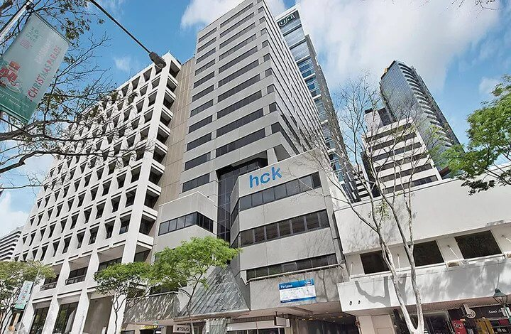 HCK Sells 116 Adelaide Street Office Tower at Loss